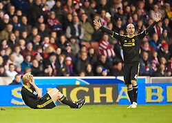 13.11.2010, Britannia Stadium, Stoke, ENG, PL, Stoke City vs Liverpool FC, im Bild Liverpool's Dirk Kuyt goes down with a facial injury during the Premiership match against Stoke City at the Britannia Stadium, EXPA Pictures © 2010, PhotoCredit: EXPA/ Propaganda/ D. Rawcliffe *** ATTENTION *** UK OUT!