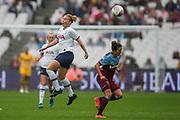Rachel Furness (Tottenham Hotspur) heads the ball with Kenza Dali (West Ham) close by during the FA Women's Super League match between West Ham United Women and Tottenham Hotspur Women at the London Stadium, London, England on 29 September 2019.