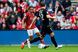 Bobby Reid of Bristol City is challenged by Chris Baird of Derby County - Rogan/JMP - 16/09/2017 - Ashton Gate Stadium - Bristol, England - Bristol City v Derby County - Sky Bet Championship.