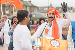 The Scottish Ganesh Festival took to the streets of Portobello in a colourful procession that made it's way down to the sea from the Town Hall. The procession was joined by local MP Tommy Shepphard and Edinburgh councillor and former lord provost Donald Wilson.<br /> © Jon Davey/ EEm
