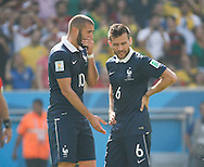 Karim Benzema of France (L) and Yohan Cabaye of France (R) speak to each other after conceding the 1st goal during the 2014 FIFA World Cup match between France and Germany at the Maracana Stadium, Rio de Janeiro<br /> Picture by Andrew Tobin/Focus Images Ltd +44 7710 761829<br /> 04/07/2014