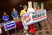 "20 OCTOBER 2010 - TEMPE, AZ: ASU freshmen Ryan Greiger (CQ) LEFT and Marissa Rhoades (CQ) pose with ""Heddy"" the chicken funded by the AZ Democratic party to represent Gov Jan Brewer's refusal to debate before a gubernatorial candidate forum on the Arizona State University campus in Tempe, Oct 20.  Goddard lost the election to sitting Governor Jan Brewer, a conservative Republican.     PHOTO BY JACK KURTZ"