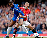 Photo: Daniel Hambury.<br />Chelsea v Manchester United. The Barclays Premiership. 29/04/2006.<br />Chelsea's Didier Drogba and United's Nemanja Vidic battle.