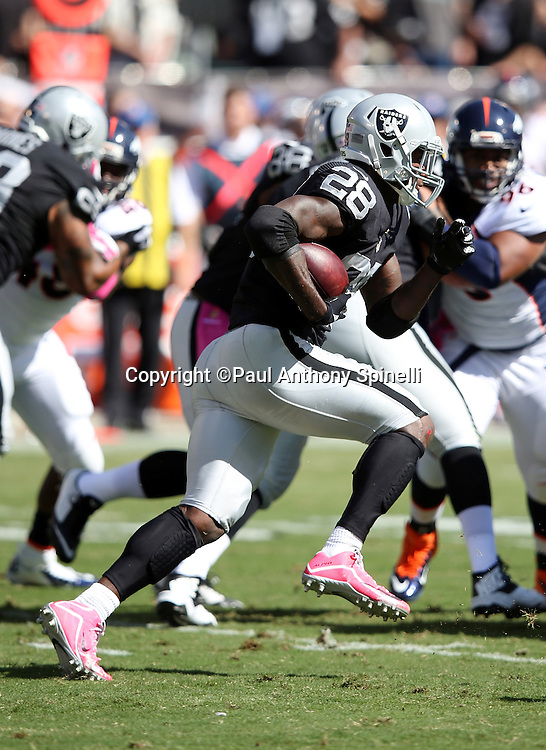 Oakland Raiders running back Latavius Murray (28) runs the ball during the 2015 NFL week 5 regular season football game against the Denver Broncos on Sunday, Oct. 11, 2015 in Oakland, Calif. The Broncos won the game 16-10. (©Paul Anthony Spinelli)