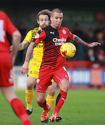 Crawley Town midfielder Jimmy Smith shields the ball from Bristol Rovers midfielder Stuart Sinclair during the Sky Bet League 2 match between Crawley Town and Bristol Rovers at the Checkatrade.com Stadium, Crawley, England on 21 November 2015. Photo by Bennett Dean.