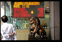 HONG KONG- OCT 28: A man stops to watch a monitor in Central as the Heng Seng Index drops 13 percent to 8,776 the largest slide since 1989, amid the Asian financial crises.  (Photo by David Paul Morris)