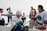 The Stonedam Islanders team takes a breathing after winning the semi final round against the Wrap Solutions team during Sunday's final rounds of the New England Pond Hockey Classic.  (Karen Bobotas/for the Laconia Daily Sun)