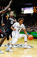 November 24th, 2013:  Colorado Buffaloes sophomore forward Xavier Johnson (2) attempts to get past Harvard Crimson senior guard Laurent Rivard (0) in the first half of the NCAA Basketball game between the Harvard Crimson and the University of Colorado Buffaloes at the Coors Events Center in Boulder, Colorado