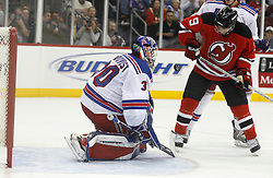 November 14, 2007; Newark, NJ, USA;  New Jersey Devils left wing Zach Parise (9) battles for the loose puck after a save by New York Rangers goalie Henrik Lundqvist (30) during the second period at the Prudential Center in Newark, NJ.  The Rangers won the game 4-2.