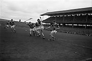 06/09/1964<br /> 09/06/1964<br /> 6 September 1964<br /> All-Ireland Senior Final: Tipperary v Kilkenny at Croke Park, Dublin.<br /> Tipperary forward, J. Doyle (left) swings his hurl with one hand and beats the two Kilkenny backs to send the ball into the Kilkenny net. (Notice how he is held by the left arm)