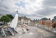 For her fine art degree show, at Chelsea College of Art, a sailor and artist re-lives a solo transatlantic yacht race by being marooned next to the Tate for 28 days. Investigating solitude, she has no physical contact with the outside world and spends her time trimming sails and making sculptures by stringing her waste together.