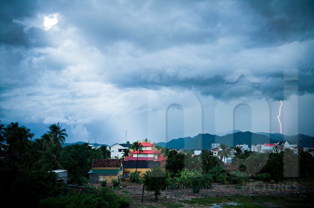Storm and lightning over the city of Nha Trang, Vietnam, Asia. The atmosphere is heavy and dark with dramatic clouds.