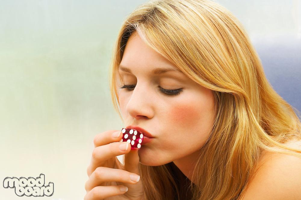 Woman Kissing Dice close up