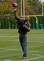 "October 8, 2009; Florham Park, NJ; USA; Floyd ""Money"" Mayweather throws a pass after the New York Jets Practice in Florham Park, NJ."