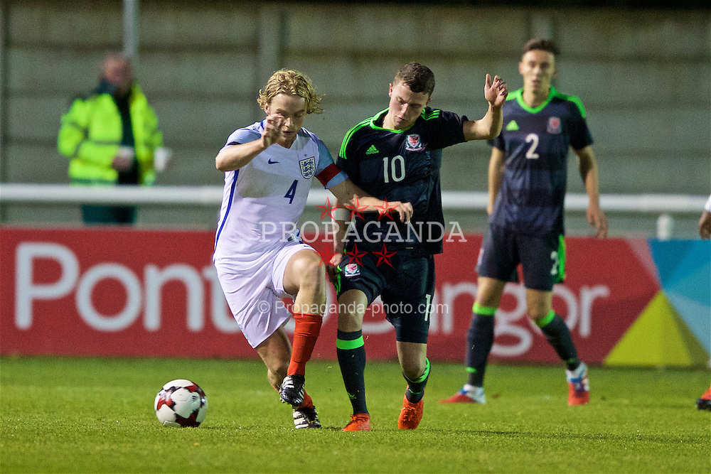 BANGOR, WALES - Saturday, November 12, 2016: Wales' Nathan Broadhead in action against England's captain Tom Davies during the UEFA European Under-19 Championship Qualifying Round Group 6 match at the Nantporth Stadium. (Pic by Gavin Trafford/Propaganda)