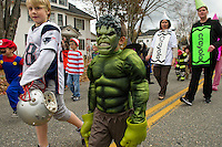 "Andrew Smith walks with his buddy ""The Incredible Hulk"" David Jean during Pleasant Street School's Halloween parade through the streets of Laconia Wednesday afternoon.  (Karen Bobotas/for the Laconia Daily Sun)"