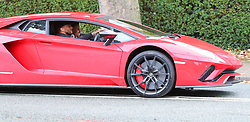 Leicester City's Danny Simpson is seen driving his red £400,000 Lamborghini Aventador LP 740 sports car in Hale, Cheshire