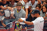 Lewis Hamilton (GBR) Mercedes AMG F1 with fans in the pit lane.<br /> Italian Grand Prix, Thursday 4th September 2014. Monza Italy.
