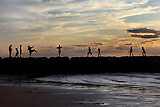 I was photographing in the other directoin at Cold Storage Beach in Dennis, MA when I turned around and saw eoplesilhouetted on the jetty. I loved how expressive their body positions were and felt that the moment really captured the magic of a summer evening on Cape Cod.