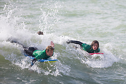 © Licensed to London News Pictures. 15/10/2016. Brighton, UK. Members of the Brighton Surf Life Saving Club (SLSC) take part in their weekly training session. Photo credit: Hugo Michiels/LNP