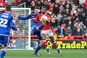 Cardiff City defender, Sean Morrison (4) and Bristol City striker, Kieran Agard (10) tussle for the ball during the Sky Bet Championship match between Bristol City and Cardiff City at Ashton Gate, Bristol, England on 5 March 2016. Photo by Shane Healey.