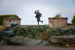 © Licensed to London News Pictures. 05/04/2020. Morecambe, UK. A statue of popular British comedian Eric Morecambe is seen wearing protective gloves and a mask on the normally busy promenade of Morecambe Bay in North West England , as people heed instructions to stay at home on what is the warmest day of the year so far . NHS staff are complaining of shortages of vital PPE ( Personal Protective Equipment ) as they work to combat the Covid-19 outbreak in the UK . People are instructed to stay at home and avoid social contact as part of quarantine measures to prevent the spread of Coronavirus ( COVID-19 ) . Photo credit: Joel Goodman/LNP
