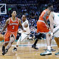 21 December 2012: Milwaukee Bucks point guard Brandon Jennings (3) drives past Boston Celtics point guard Rajon Rondo (9) on screen set by Milwaukee Bucks center Larry Sanders (8) during the Milwaukee Bucks 99-94 overtime victory over the Boston Celtics at the TD Garden, Boston, Massachusetts, USA.