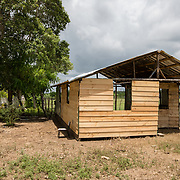 A new-build and still very vulnerable home in the la Cubana area of San Pedro Province, Dominican Republic, September 12, 2017. The area was not badly damaged by Hurricane Irma, though it is prone to diseases, especially now in the rainy season with increased rainfall during the hurricane. Several areas with stagnant water are breeding grounds for mosquitos, increasing cases of dengue, chikungunya, zika and others. stands with two of her seven children in front of their house in the la Cubana area of San Pedro Province in the Dominican Republic, September 12, 2017. The area was not badly hit by Hurricane Irma, though it is prone to diseases, especially now in the rainy season with increased rainfall during the hurricane. Several areas with stagnant water are breeding grounds for mosquitos, increasing cases of dengue, chikungunya, zika and others.