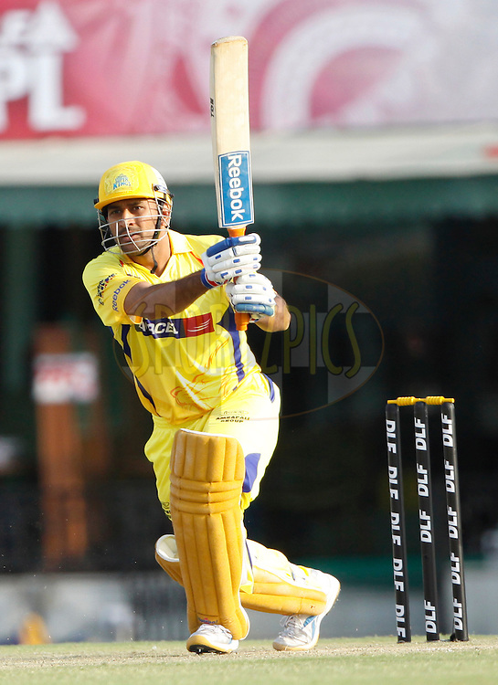 Chennai Super King captain MS Dhoni plays a shot during match 9 of the Indian Premier League ( IPL ) Season 4 between the Kings XI Punjab and the Chennai Super Kings held at the PCA stadium in Mohali, Chandigarh, India on the 13th April 2011..Photo by Pankaj Nangia/BCCI/SPORTZPICS