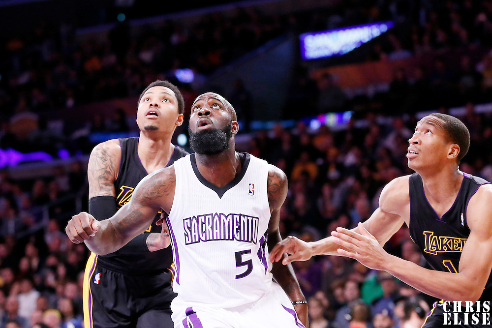 28 February 2014: Sacramento Kings small forward Quincy Acy (5) yes for the rebound with Los Angeles Lakers shooting guard Kent Bazemore (6) and Los Angeles Lakers small forward Wesley Johnson (11) during the Los Angeles Lakers 126-122 victory over the Sacramento Kings at the Staples Center, Los Angeles, California, USA.