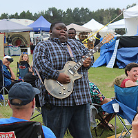 "Christone ""Kingfish"" Ingram meanders through the crowd of the festival Saturday while playing a guitar solo."
