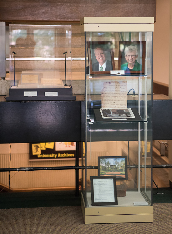 Photos of Duane and Ruthie Nellis sit  display as part of an inaugration display at Alden Library.