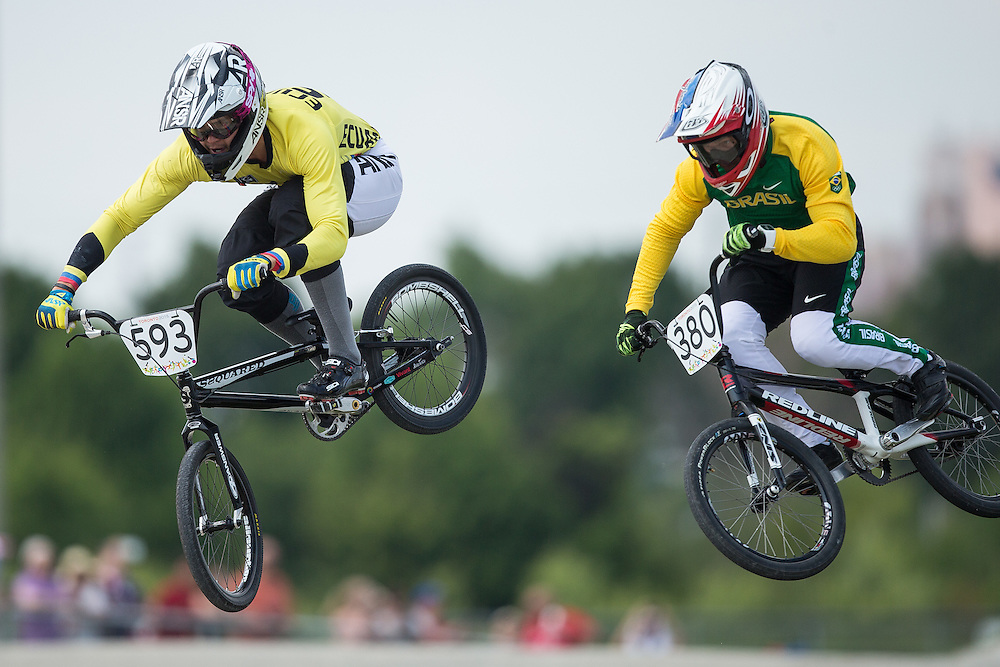 Riders Alfredo Campo Vintimilla (L) of Ecuador and Anderson Ezequiel De Souza Filho of Brazil race in the semi-final at the BMX competition at the 2015 Pan American Games in Toronto, Canada July 11,  2015.  AFP PHOTO/GEOFF ROBINS