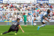 Reading Tom McIntyre challenge on Huddersfield Town Adama Diakhaby during the EFL Sky Bet Championship match between Huddersfield Town and Reading at the John Smiths Stadium, Huddersfield, England on 24 August 2019.