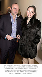 MR SEBASTIAN SAINSBURY and MISS GISELE ROMAN, at an exhibition in London on 5th April 2001.OMW 90