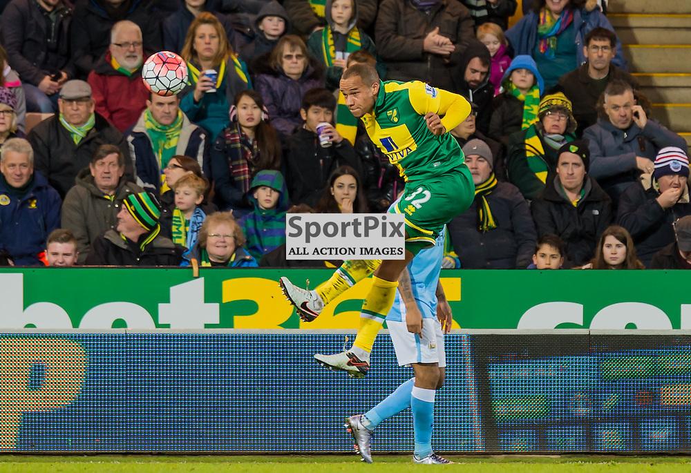 Norwich City midfielder Vadis Odjidja-Ofoe (32) put in a powerful header