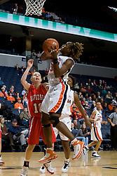 Virginia center Aisha Mohammed (33) shoots over Davidson guard Alexandra Thompson (10).  The Virginia Cavaliers women's basketball team defeated the Davidson Wildcats 83-68 at the John Paul Jones Arena in Charlottesville, VA on December 20, 2007.