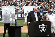 Former Oakland Raiders head coach John Madden speaks at halftime during a tribute to recently deceased Oakland Raiders quarterback Kenny Stabler as former teammates look on during the 2015 NFL week 1 regular season football game against the Cincinnati Bengals on Sunday, Sept. 13, 2015 in Oakland, Calif. The Bengals won the game 33-13. (©Paul Anthony Spinelli)