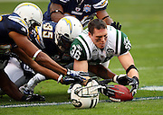 New York Jets safety Jim Leonhard (36) dives without his helmet for an apparent fumble as San Diego Chargers fullback Mike Tolbert (35) and other Chargers also dive for the loose ball during the AFC Divisional Playoff game against the San Diego Chargers, January 17, 2010 in San Diego, California. The Jets won the game 17-14. ©Paul Anthony Spinelli