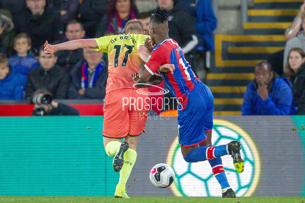 Crystal Palace forward Wilfried Zaha (11) clashes with Manchester City midfielder Kevin De Bruyne (17), VAR, during the Premier League match between Crystal Palace and Manchester City at Selhurst Park, London, England on 19 October 2019.