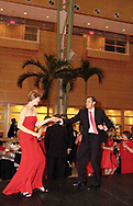 Dr. Anne Cata (left) and Dr. Ceferino Cata use the runway as a dance floor at the 2007 Wellness Connection Red Dress Gala, at the Schuster Performing Arts Center in Dayton, Saturday night, May 5th.  He's a cardiologist and she is a pediatrician.