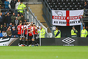 Brentford defender Henrik Dalsgaard (22) scores and Brentford celebrate 1-0 during the EFL Sky Bet Championship match between Derby County and Brentford at the Pride Park, Derby, England on 22 September 2018.