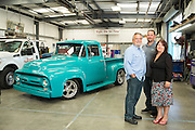 Founder Rich Mello, left, General Manager Jason Cocco, and Vice President Kathy Mello pose for a portrait at T.G.I.F. Body Shop, Inc., in Fremont, California, on April 17, 2014. (Stan Olszewski/SOSKIphoto)