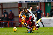 Hearts FC Forward Juanma Dalgado and Motherwell FC Defender Keiran Kennedy collide during the Ladbrokes Scottish Premiership match between Motherwell and Heart of Midlothian at Fir Park, Motherwell, Scotland on 28 November 2015. Photo by Craig McAllister.