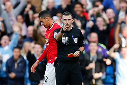 referee Michael Oliver points after showing a red card to Chris Smalling of Manchester United after a challenge on James Milner of Manchester City - Photo mandatory by-line: Rogan Thomson/JMP - 07966 386802 - 02/11/2014 - SPORT - FOOTBALL - Manchester, England - Etihad Stadium - Manchester City v Manchester United - Barclays Premier League.