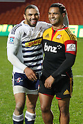 Bryan Habana and Lelia Massaga share a smile and a joke at the end of their Investec Super 15 Rugby match, Chiefs v Stormers, at Waikato Stadium, Hamilton, New Zealand, Saturday 14 May 2011. Photo: Dion Mellow/photosport.co.nz