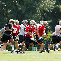 July 29, 2011; Metairie, LA, USA; New Orleans Saints players run sprints during the first day of training camp at the New Orleans Saints practice facility. Mandatory Credit: Derick E. Hingle