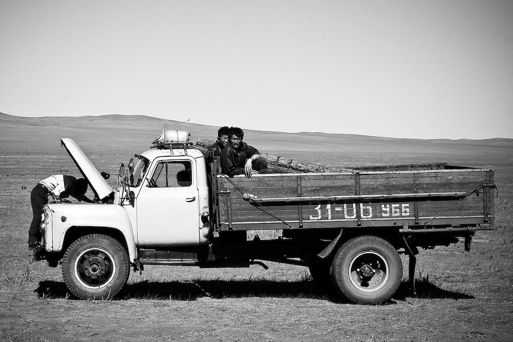 Men repair a truck in central Mongolia.