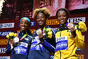 Women's 100m hurdles gold medalist Nia Ali (center) poses with silver medalist Keni Harrison aka Kendra Harrison (USA), right, and bronze medalist Danielle Williams during the IAAF World Athletics Championships, Sunday, Oct.. 6, 2019, in Doha, Qatar. (Jiro Mochizuki/Image of Sport)