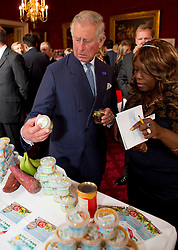 LONDON - UK - 10- SEPT - 2013: Britain's Prince Charles, The Prince of Wales, President, The Prince&rsquo;s Initiative for Mature Enterprise (PRIME), hosts a reception to celebrate PRIME entrepreneurs over the age of 50, supporters and volunteers, St James&rsquo;s Palace State Apartments, London. HRH also viewed some of the products produced by PRIME businesses.<br /> The Prince meets baby food producer Marvo Straughn.<br /> Photo by Ian Jones
